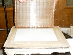 Formed page will be placed on damp cloth to dry slowly