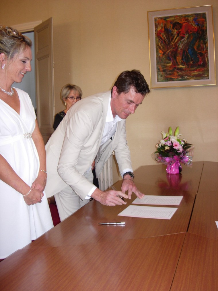 Loic and Audrey sign the register