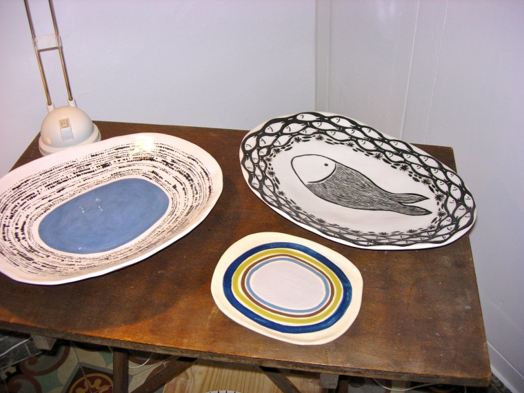 Pair of platters and small plate